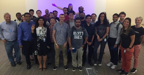 A group of 26 presenters and event organizers at the Cloud Native Open Infra Day in Santa Clara, California